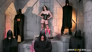 Amazing brunette slut in a fantastic black corset is ready for a really nasty treatment. Bunch of monks stimulate her tight anus and she just loves it.