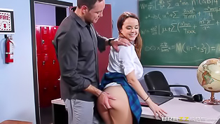 Lustful schoolgirl wearing awesome unifrom is getting penetrated by her passionate teacher in the middle of the classroom. She likes this class.