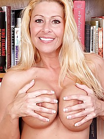 Bimbo blonde-esque MILF shows off her alluring pussy to the viewer