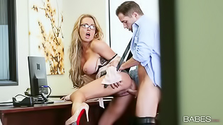 Awesome blonde wearing glasse and black lingerie is enjoying passionate sex with her boyfriend. He is covering her amazing breasts with load of cum.