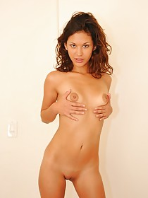 Tiny pink top Latina beauty shows her fingering prowess on camera