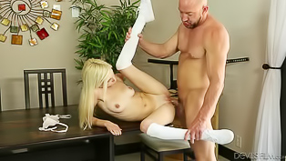 Wonderful chick having white hair is enjoying passionate sex with her strong boyfriend. She is sucking his penis and getting penetrated on the table.