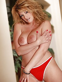 Ravishing MILF with wild hair and a red dress decides to get naked