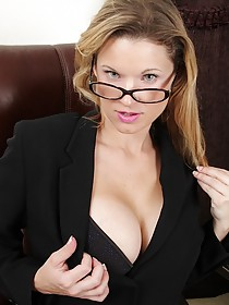 Glasses-wearing blonde MILF showing her awesome body to the viewer
